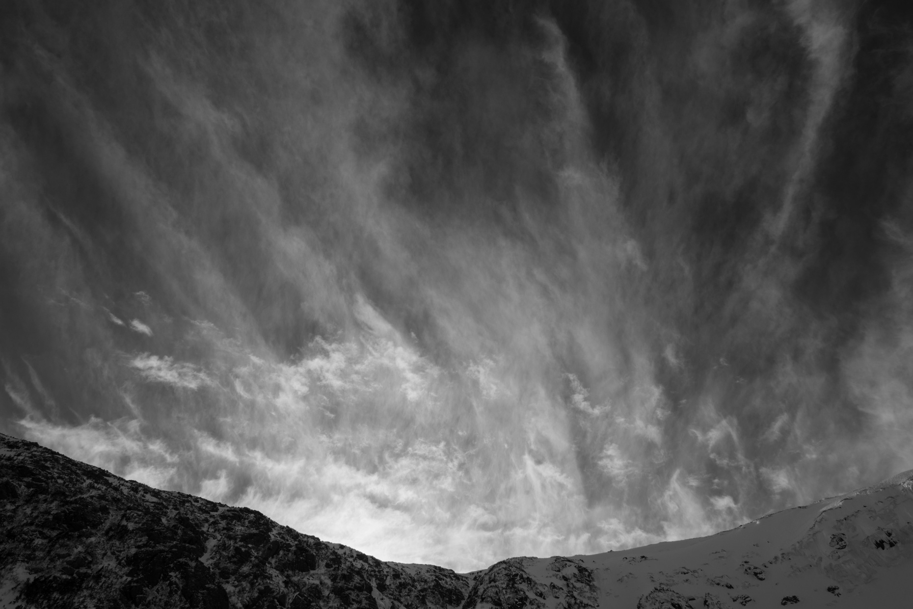 Cirrus clouds blowing over Tuckerman Ravine