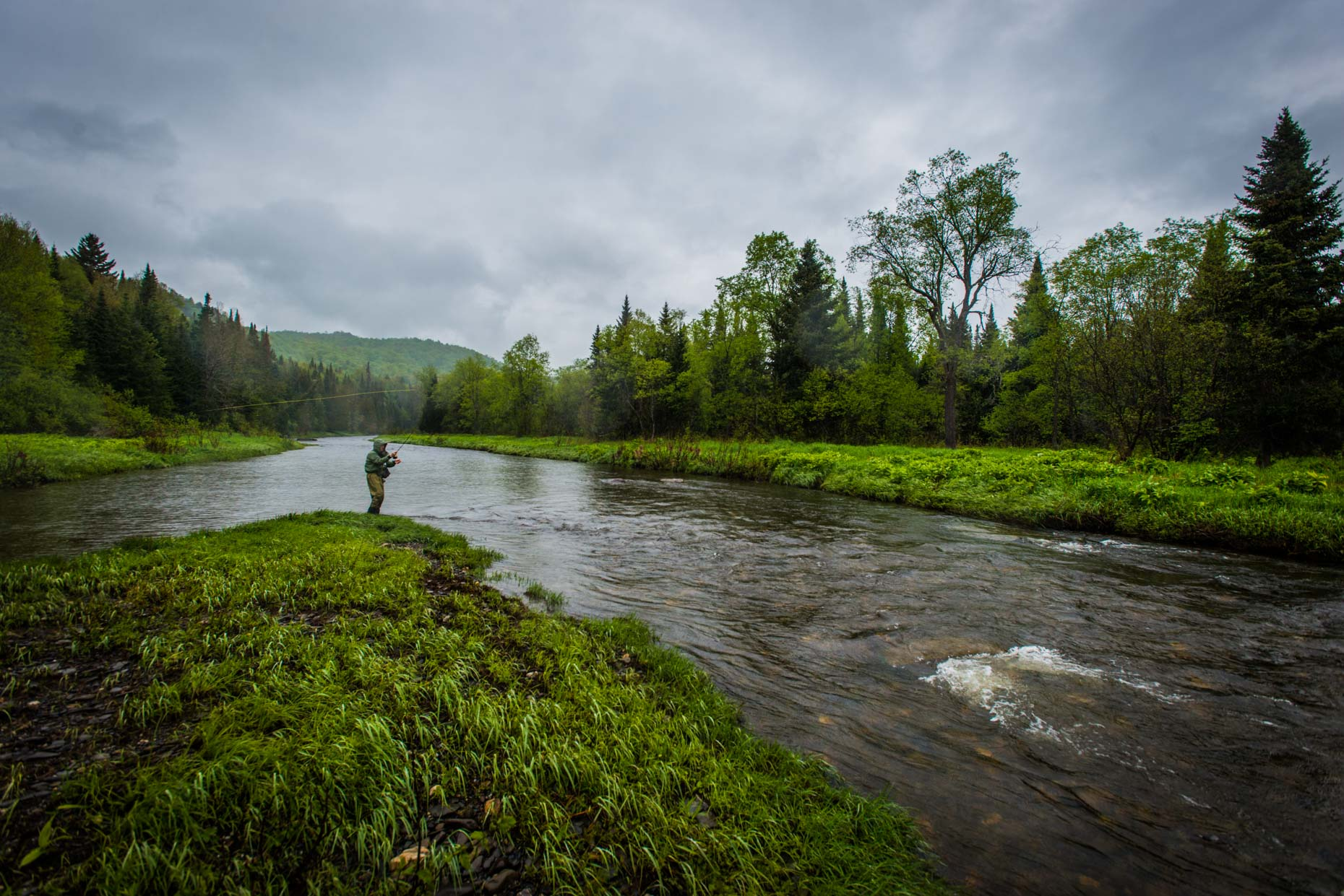 A green wet spring fly fishing near Pittsburg, New Hampshire.