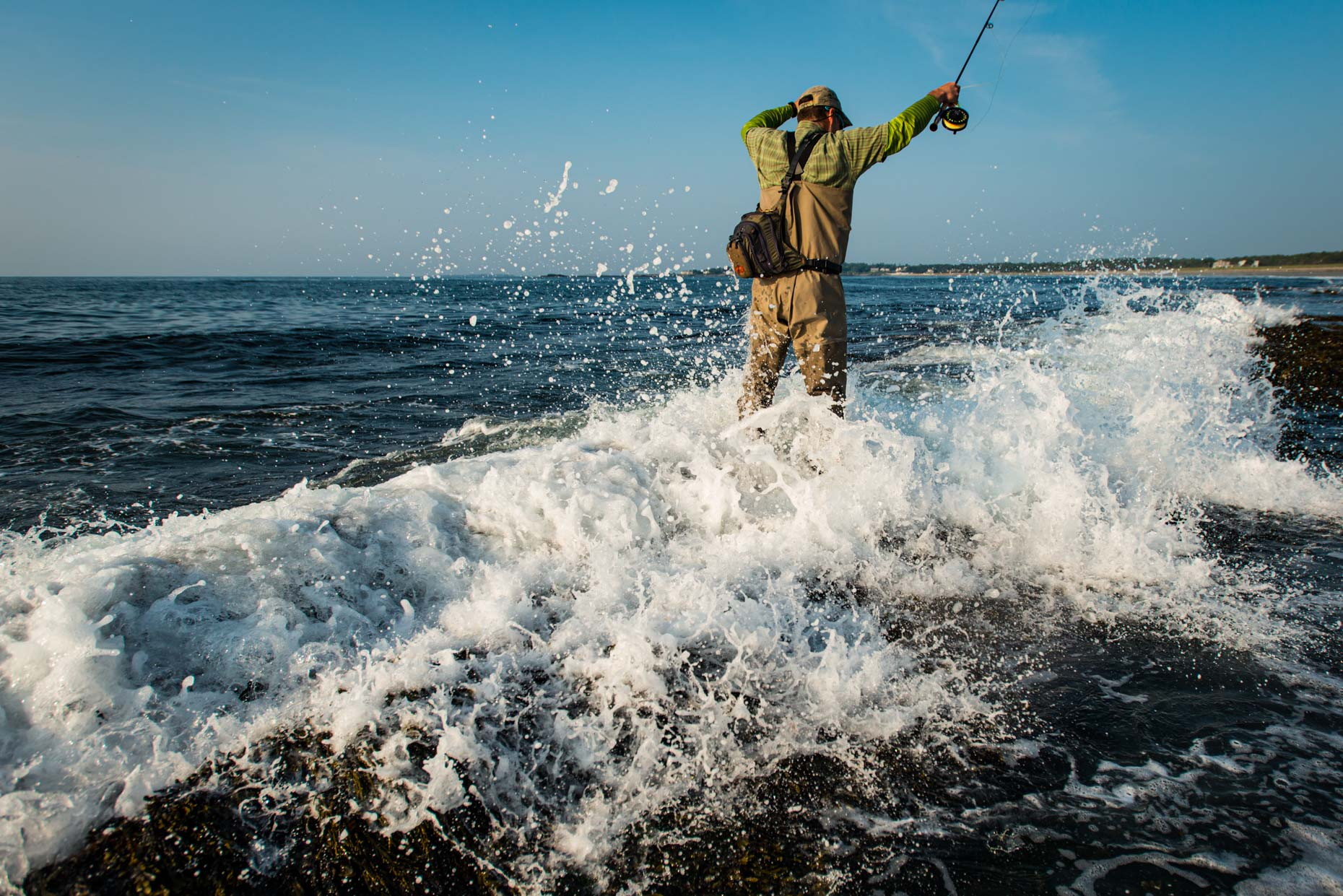 Fly fishing in the surf of Maine