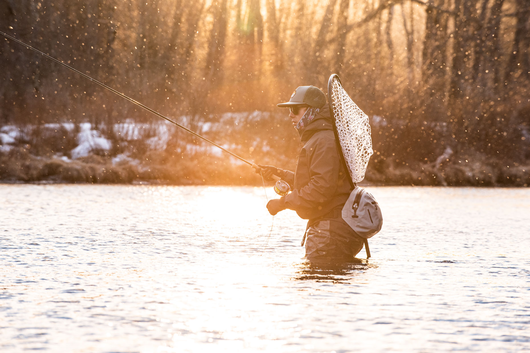 Fly fisherman in winter