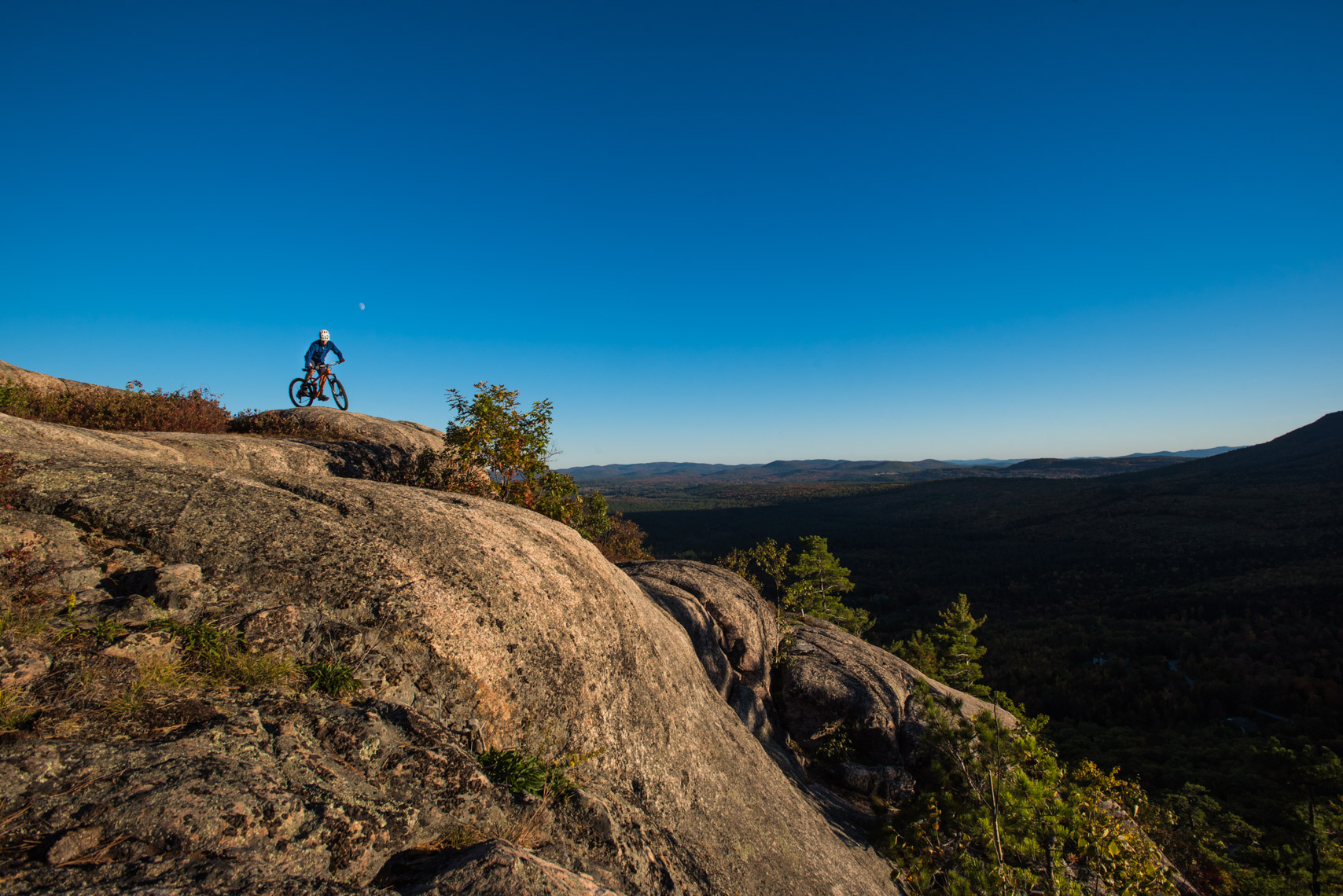 Mountain biking on Whitehorse Ledge, New Hampshire.